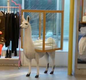 """At """"Opening Ceremony,"""" llamas or other artificial animals act as merchandise holders. Through experiences like this, stores wish to equip themselves against the competition from online commerce. Credit: Comment / Christian Mikunda"""