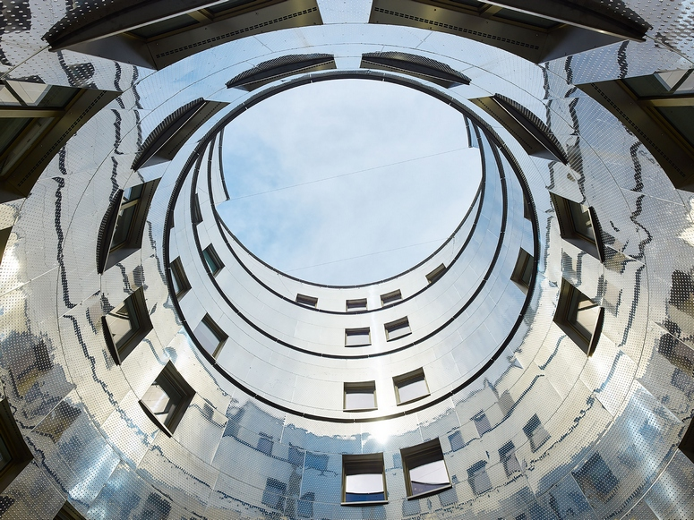 The facades found in Stafa Tower's rotunda atrium have been specifically developed for the building and constitute a significant innovation. Image: Bruno Klomfar
