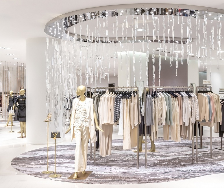 The store design, featuring corrugated glass shards in the form of icicles, of Saks Fifth Avenue's third floor in Toronto is reminiscent of the local woodlands. Image: EHI