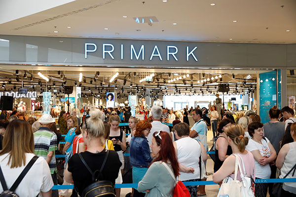 Crowds of customers waiting outside the new Primark store, Credit: Tina Ramujkić